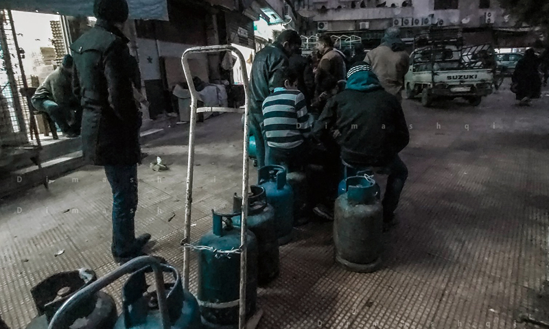 Syrian citizens waiting in line for Gas cylinder in Al Abbasiyyin Square in Damascus, 13 February 2020 (Lens young Dimashqi)
