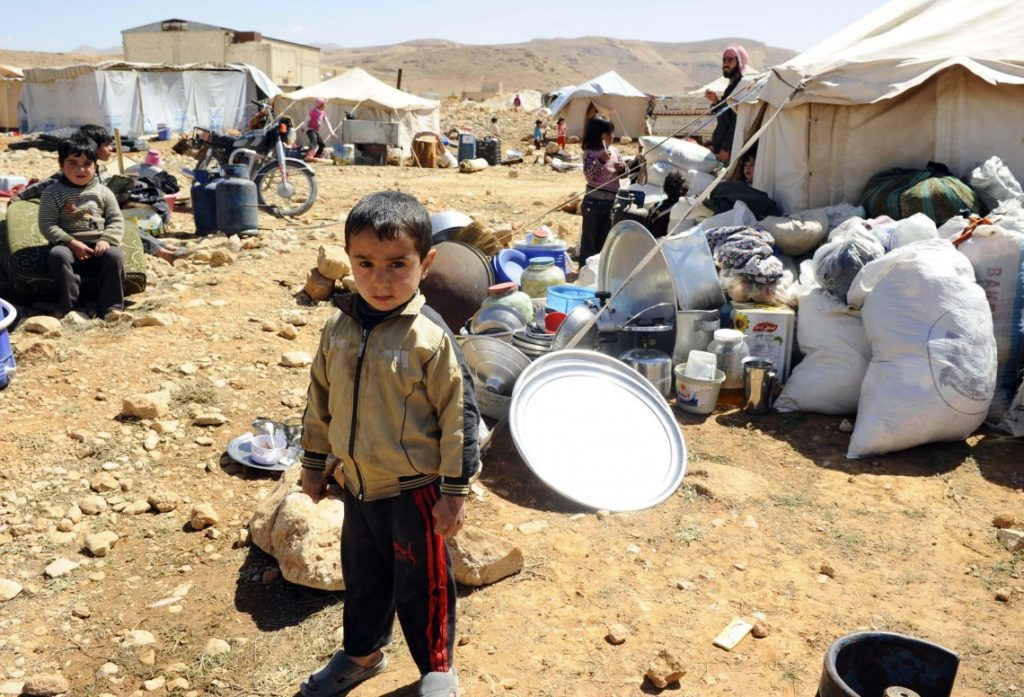A Syrian refugee child in Aarsal - 20 March 2014 (AFP)