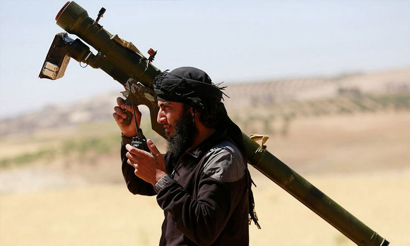 A fighter from the opposition factions holding a surface-to-air missile (Reuters)