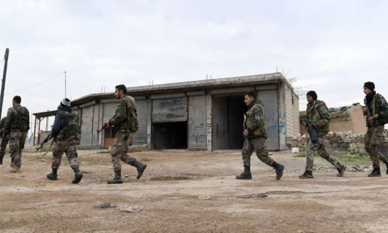 Syrian regime forces in the village Tell Touqan in Idlib countryside - 5 February 2020 (AFP)