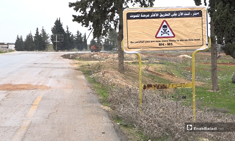A sign on the international highway between Damascus and Aleppo in the city of Saraqib, Idlib countryside - 1February, 2020 (Enab Baladi)