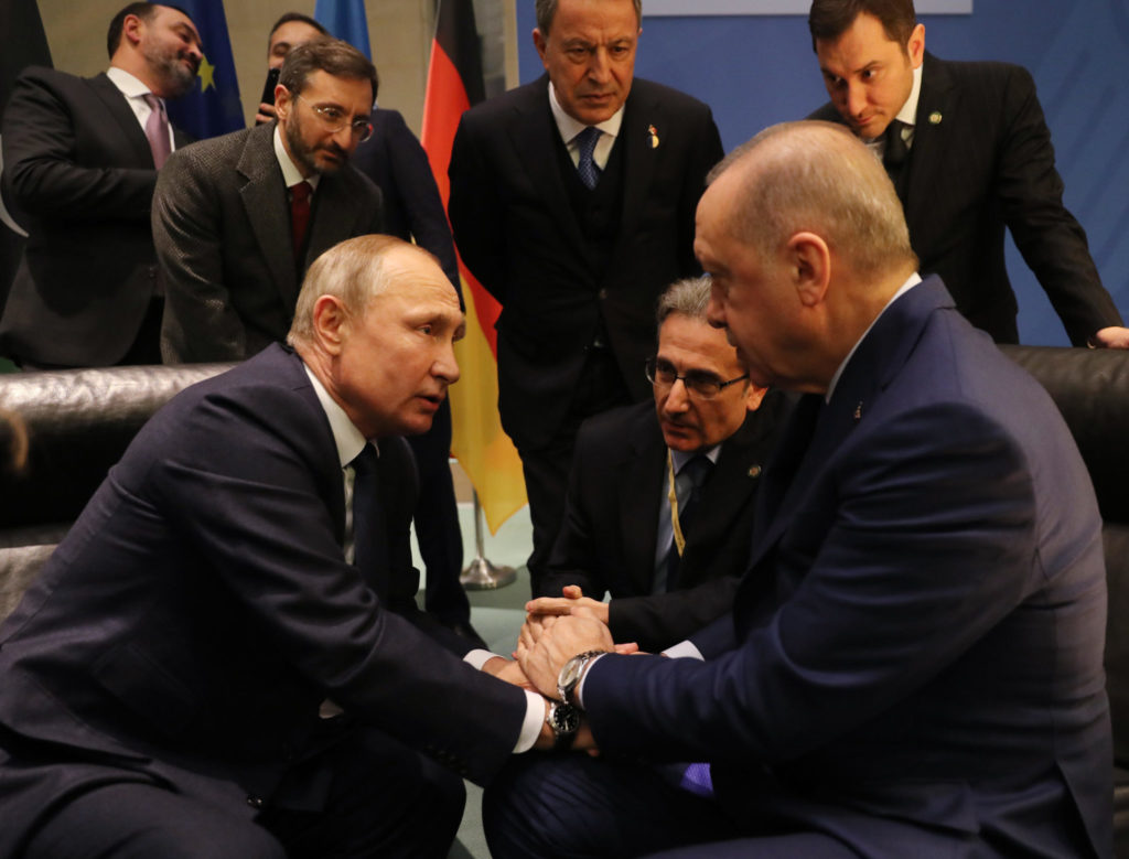 Turkish President Recep Tayyip Erdogan (on the right side) talking to Russian President Vladimir Putin (on the left side) at the Berlin Conference on Libyan Peace- 19 January 2020 (AFP)