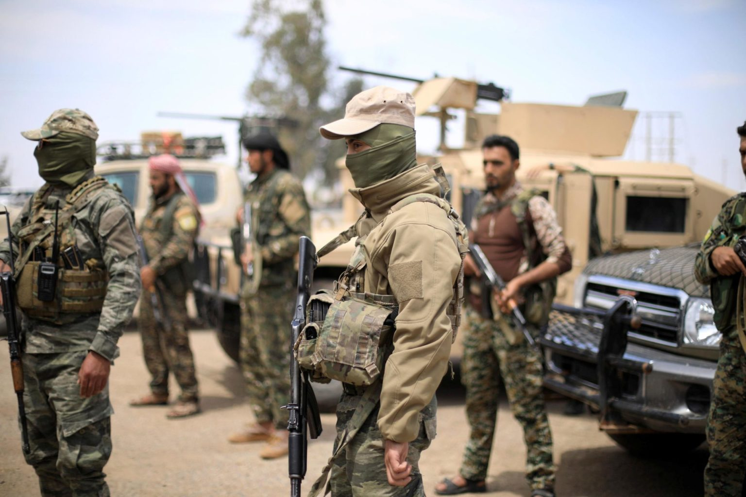 """Members of the """"Syrian Democratic Forces"""" (SDF) in the countryside of Deir Ezzor (Reuters)"""