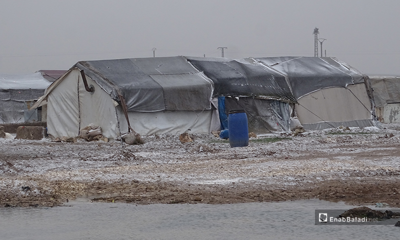 The residents of al-Marj camp face a brutal snowstorm in the town of Ehtemlat in the northern countryside of Aleppo - 12 Februray 2020 (Enab Baladi)