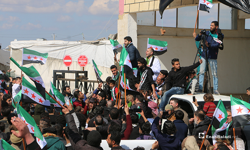 """People held demonstrations at the """"Bab al-Salameh"""" border crossing with Turkey, calling for battles to continue against the Syrian regime - 25 February 2020 (Enab Baladi)"""