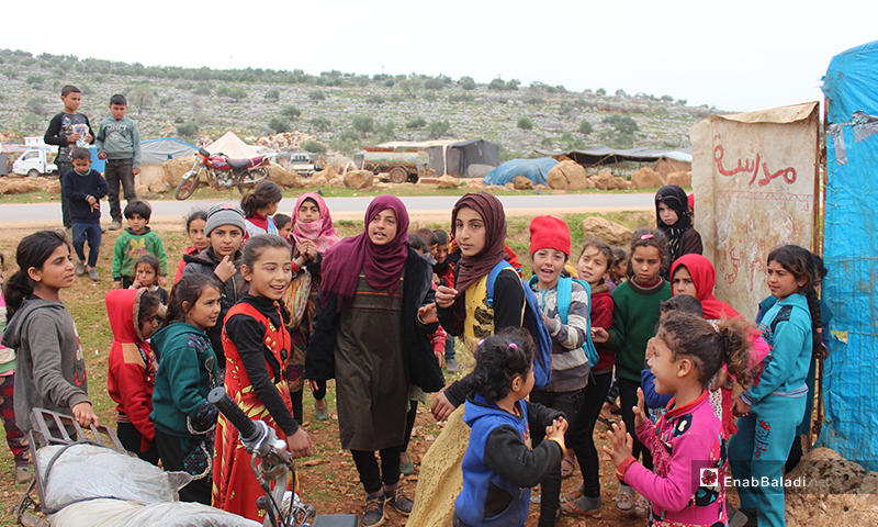 150 Female and male students get education in a worn-out tent in camps east of Kafr Arouk village, north of Idlib - 12 March 2020