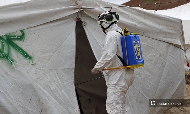 Disinfecting the entrance of a tent in the IDPs' camp of Dabiq town in northern rural Aleppo – 29 March 2020 (Enab Baladi)