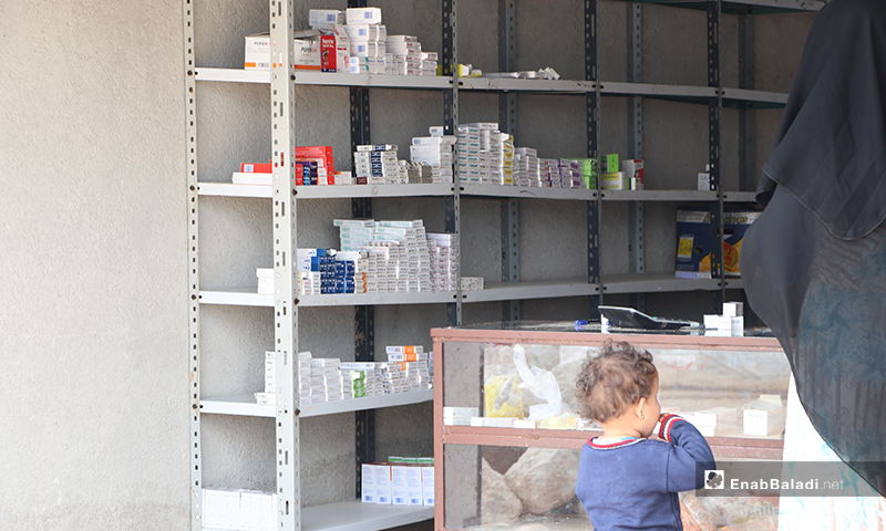 A child in front of the al-Azraq camp's pharmacy in al-Bab city of rural Aleppo – 25 March 2020 (Enab Baladi)