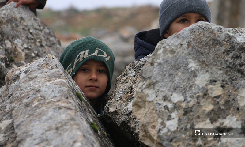 Children playing on the ruins of Deir Amman in the western countryside of Aleppo - January 19, 2020 (Enab Baladi)