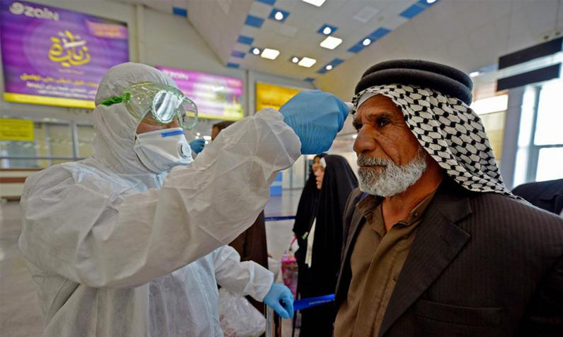 An Iraqi citizen having a coronavirus checking test (AFP)