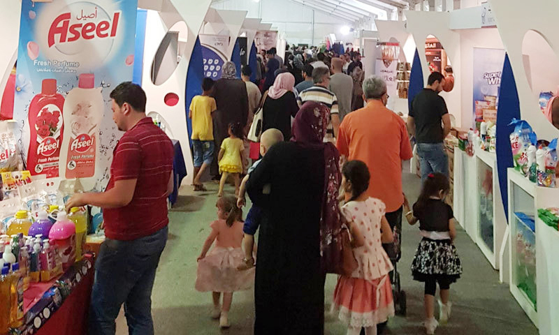 """""""Made in Syria"""" exhibition in the Libyan city of Benghazi, 25 May, 2018 (al-Iqtissad Al-Youm)"""