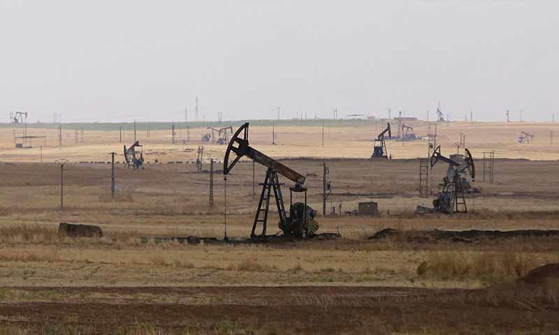 Oil well pumps in Rmelan oilfield in al-Hasakah province (AFP)
