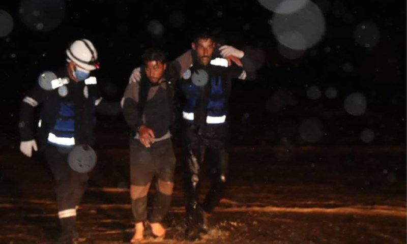 The emergency medical teams, affiliated to the Kurdish Autonomous Administration trying to rescue civilians in the southern countryside of Raqqa, who were washed away by the torrential floods triggered by the heavy rains - 27 March 2020 ( Raqqa Civil Council)