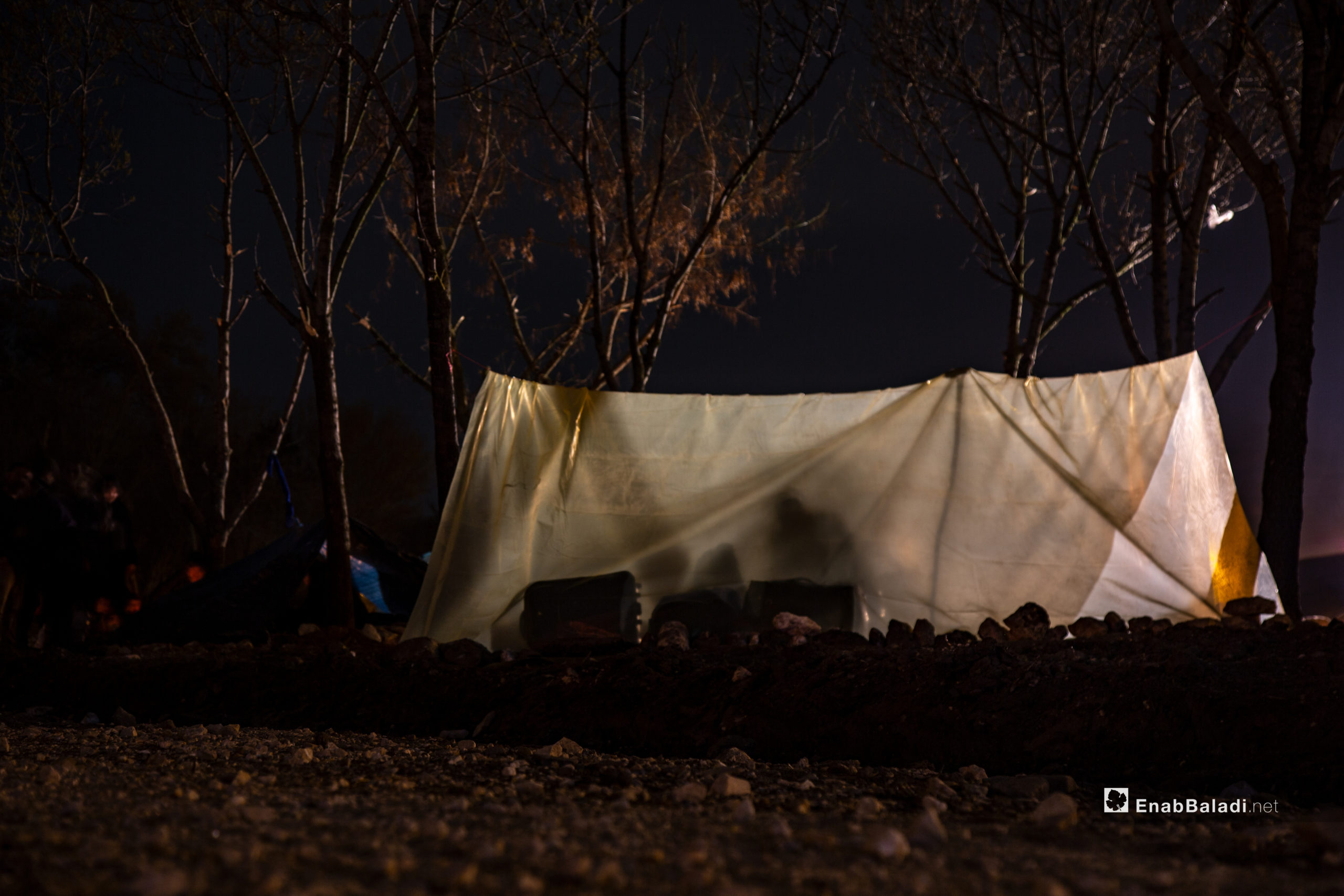 Migrants assemble on the Turkey-Greece border buffer zone near the Pazarkule crossing gate in Edirne, Turkey, hoping that Greece will open the border gate soon - 4 March 2020 (Enab Baladi)