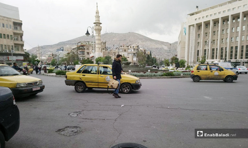 Taxis in Sabaa Bahrat Square, center of the capital, Damascus - April 20, 2019 (Enab Baladi)