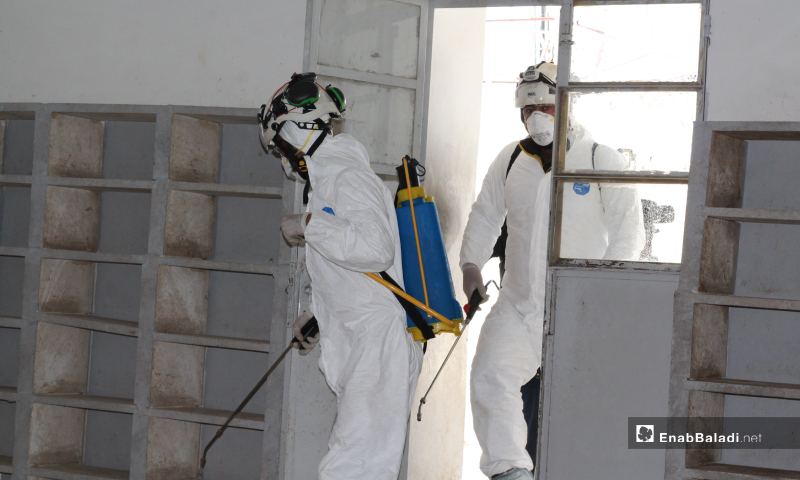 The Syrian civil defense teams carried out a disinfecting campaign for vital facilities in Akhtarin city north of Aleppo to prevent the spread of the novel coronavirus (Covid-19) – 24 March 2020 (Enab Baladi)