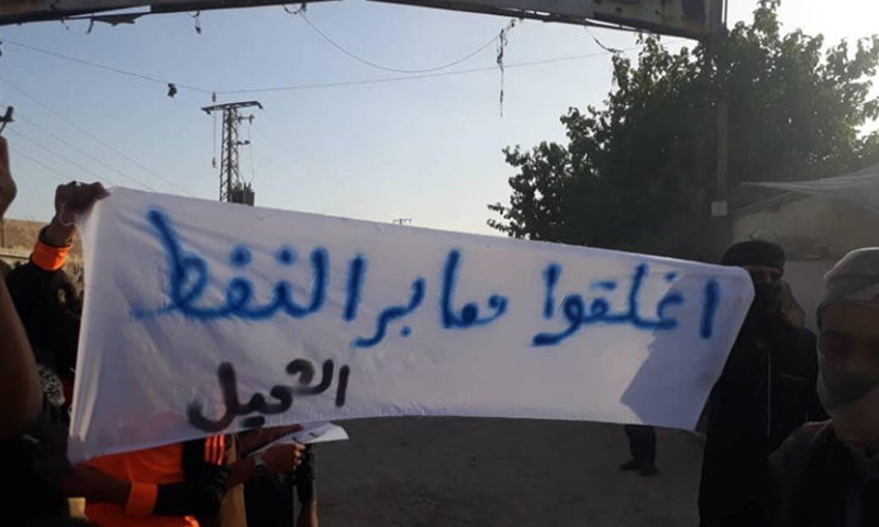 Demonstrators held banners against the Kurdish Democratic Forces in the al-Shuhay area in the countryside of Deir Ezzor - 2 May 2019 (al-Sharqiya 24)
