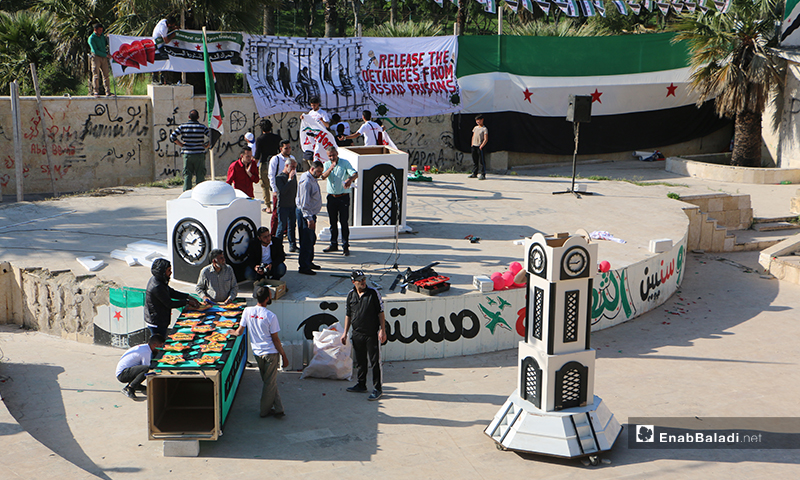 Demonstrators in Idlib city's Public Park's theater commemorated the anniversary of the Clock Tower sit-in in Homs city center– 19 April 2020 (Enab Baladi)