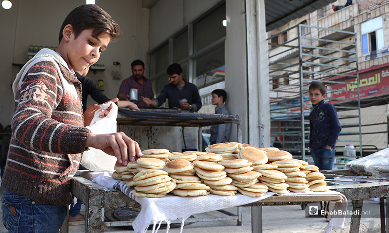 A child selling Qatayef in al-Bab city in rural Aleppo before the call to sunset prayer and iftar – 25 April 2020 (Enab Baladi)