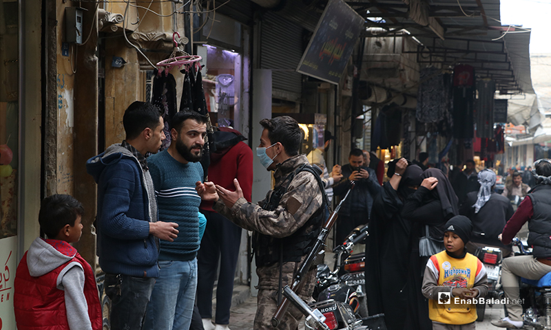 A member of the Special Police Forces encouraging al-Bab residents to take the coronavirus danger more seriously - 28 March (Enab Baladi)