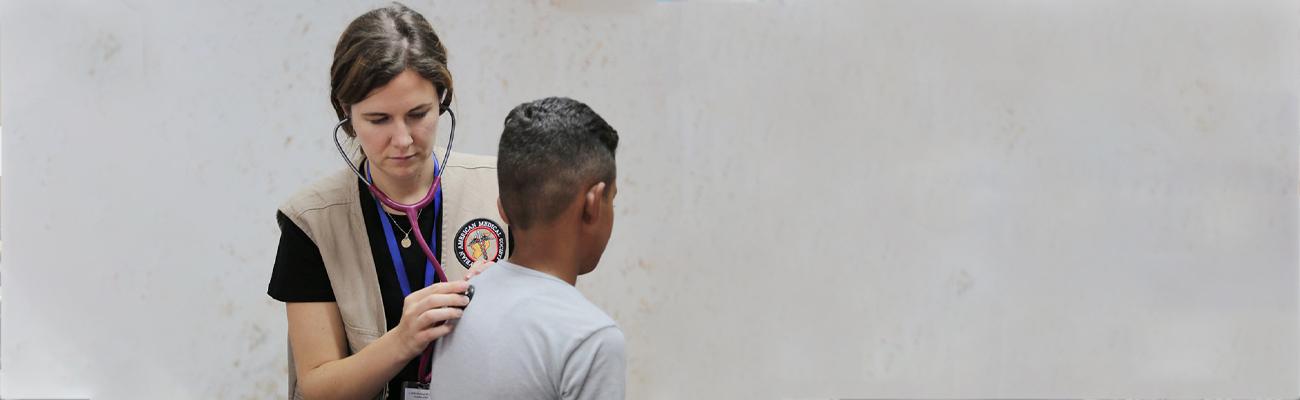 A nurse examines children at SAMS Hospital in Idlib - 2020 (SAMS)