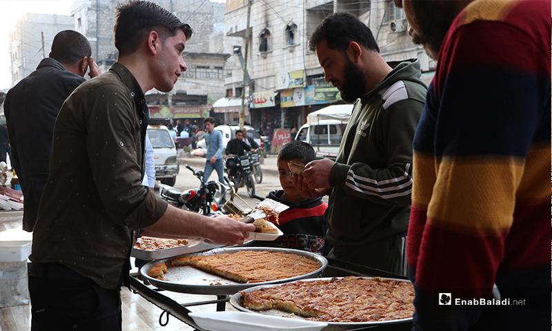 Residents of al-Bab city buying Arabian sweets before the call to sunset prayer and iftar – 25 April 2020 (Enab Baladi)