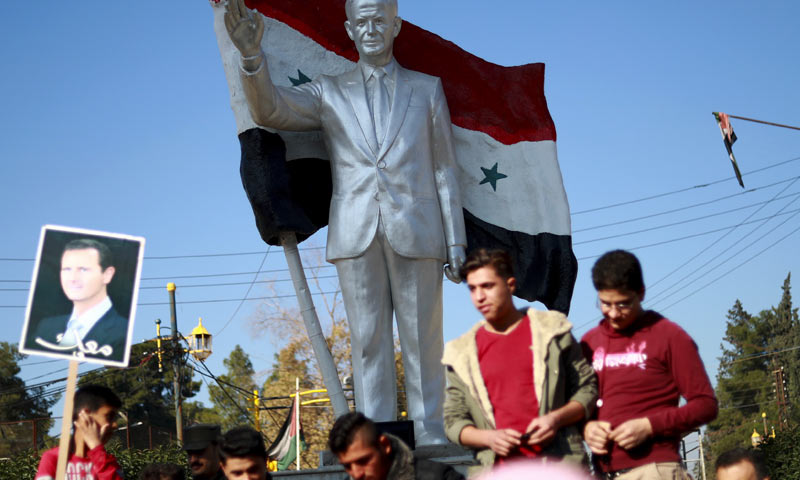 Young men participating in a rally in support of the Syrian regime in Qamishli - December 2018 (AFP)