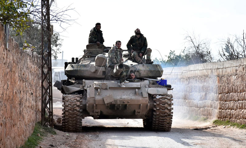 Members of the Syrian regime forces on the top of a tank in the southern countryside of Idlib - 2 February 2020 (SANA)
