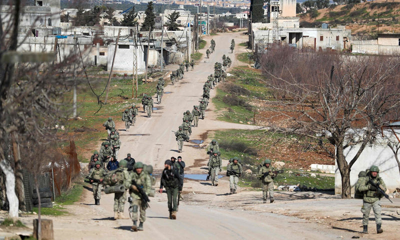 Turkish troops gather in the village of Qminas, about six kilometers (3.7 miles) southeast of Idlib - 10 February 2020 (Omar Haj Kaddour- AFP)