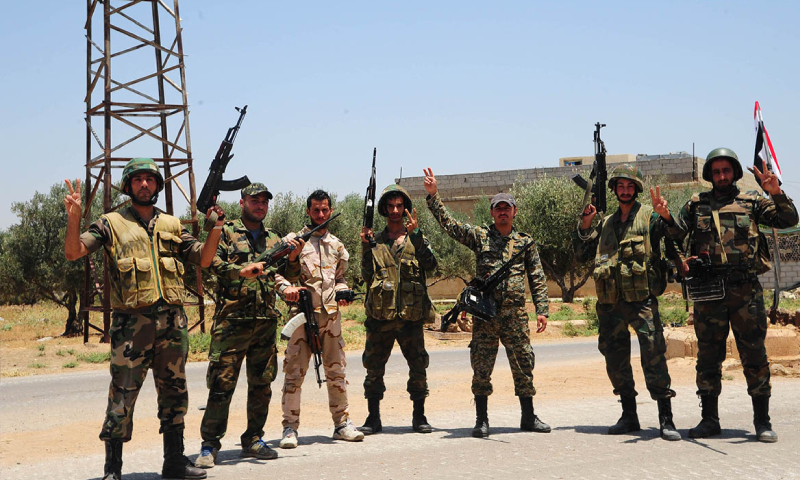 Members of the Syrian regime forces in Saida town in rural Daraa - 4 July 2018 (SANA)