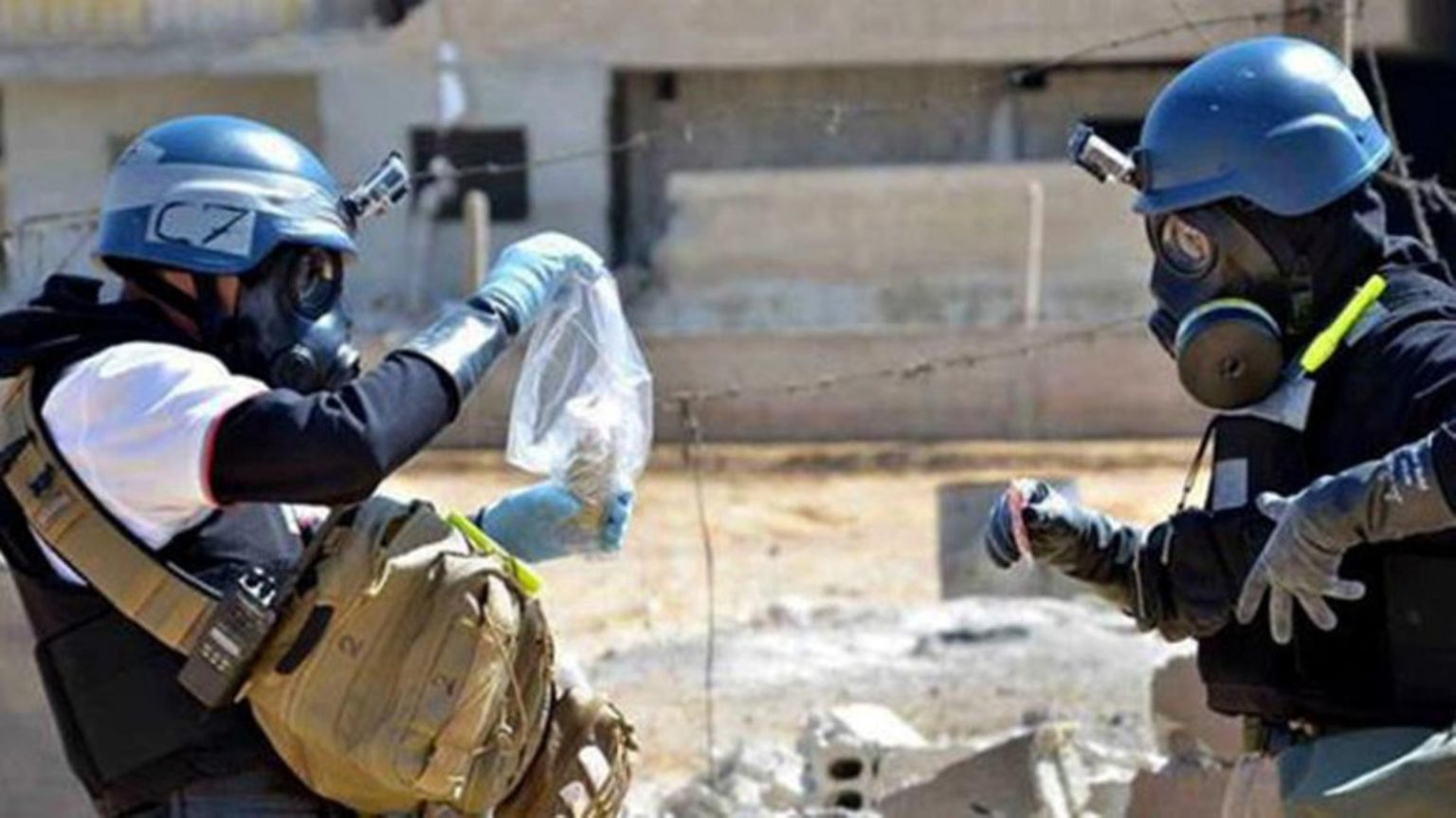OPCW's members in Eastern Ghouta in 2013 (AFP)