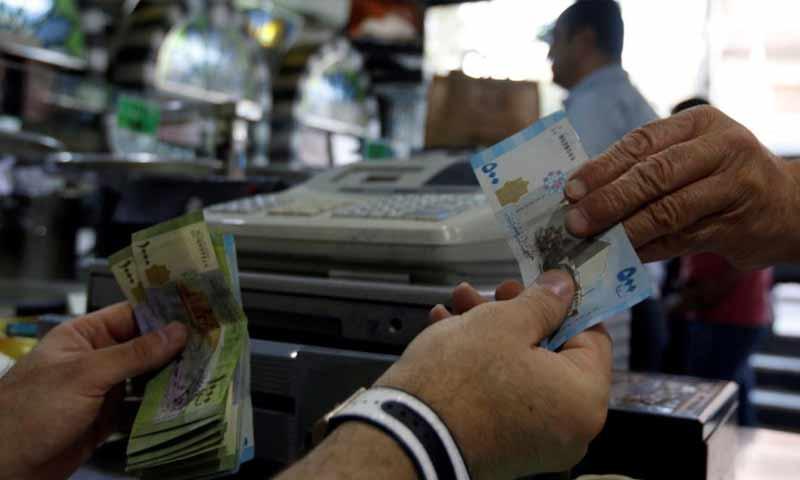 A banknote of 500 Syrian Pounds SYP (Reuters)