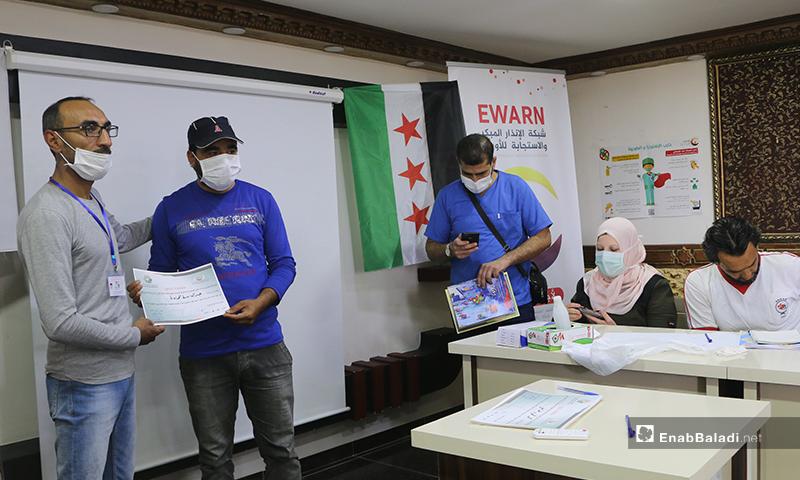 The receiving of certificates of the awareness workshop on coronavirus risks in Turkman Bareh town in northern Aleppo countryside – 21 May 2020 (Enab Baladi - Abdul al-Salam Majaan)