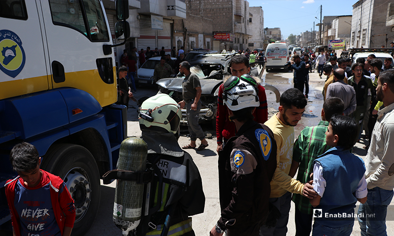 """Members of the Syrian Civil Defense at the improvised explosive device (IED) explosion site that targeted the vehicle of a member of the """"Sultan Murad"""" Division, affiliated to the Turkey-backed Syrian National Army (SNA) in al-Bab city, in the north-eastern countryside of Aleppo province – 25 May 2020 (Enab Baladi / Asim Melhem)"""