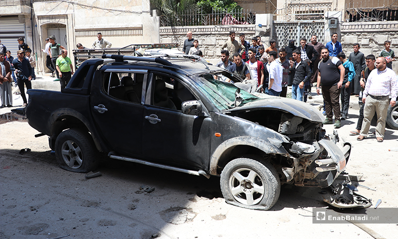 """The explosion of an improvised explosive device (IED) detonated under a pickup vehicle for one of the members of the """"Sultan Murad"""" Division, affiliated to the Turkey-backed Syrian National Army (SNA) in al-Bab city, in the north-eastern countryside of Aleppo province. The explosion injured the targeted vehicle's driver– 25 May 2020 (Enab Baladi / Asim Melhem)"""