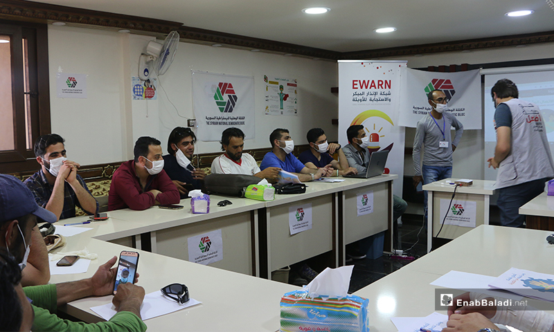 Some of the attendees of the awareness workshop on the risks of the novel coronavirus (COVID-19) pandemic in Turkman Bareh town in northern Aleppo – 21 May 2020 (Enab Baladi - Abdul al-Salam Majaan)