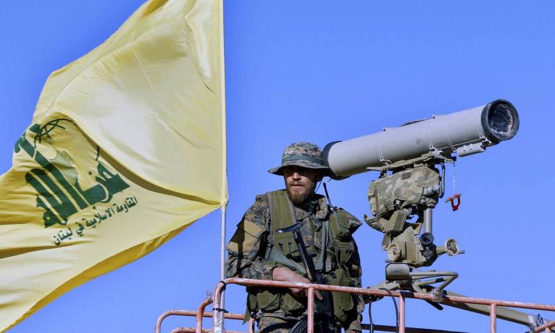 A member of the Lebanese Hezbollah militia near the M.D missile base (AP)