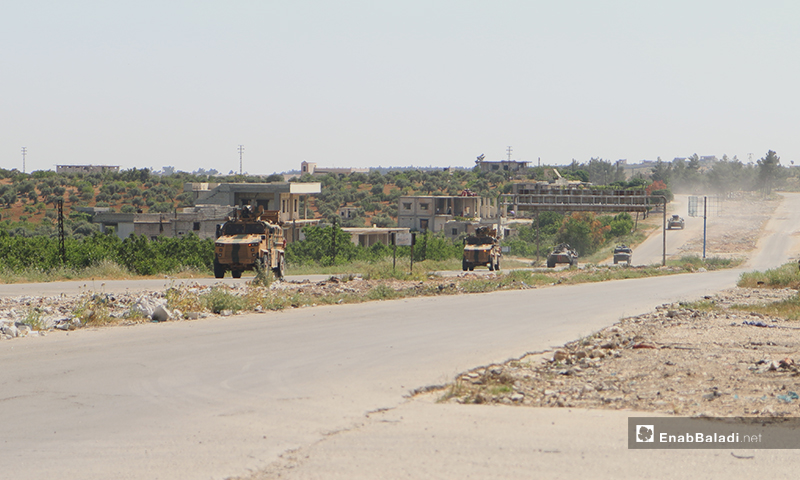 """Military vehicles on the Aleppo – Lattakia international """"M4"""" highway during the eleventh Russian-Turkish joint patrol – 14 May 2020 (Enab Baladi)"""