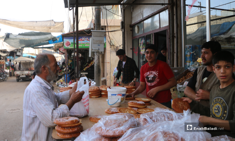 A child selling Maarouk bread, one of Ramadan's famous and popular delights in Marea city of Aleppo countryside – 20 May 2020  (Enab Baladi - Abdul al-Salam Majaan)