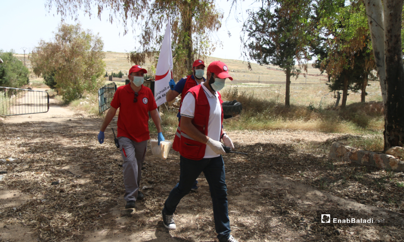 The Syrian Arab Red Crescent (SARC) during the prisoners' exchange process between the Syrian regime and the HTS – 16 May 2020 (Enab Baladi / Yousef Ghuraibi)