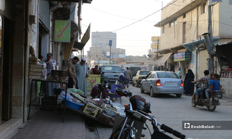 Residents buying Eid al-Fitr sweets from one of the shops in Marea city of Aleppo countryside – 20 May 2020  (Enab Baladi - Abdul al-Salam Majaan)