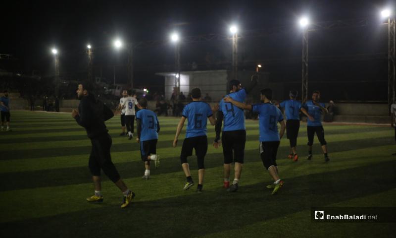 Akrabat team members celebrating their win in the final match between Deir Hassan and Akrabat teams in Kah area in Idlib – 03 May 2020 (Enab Baladi)