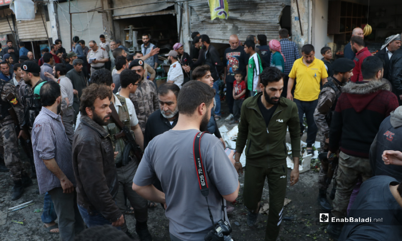 """Members of the """"Free Police"""" examining the aftermath of the IED explosion in a vegetable store in al-Raie street of al-Bab city – 10 May 2020 (Enab Baladi)"""