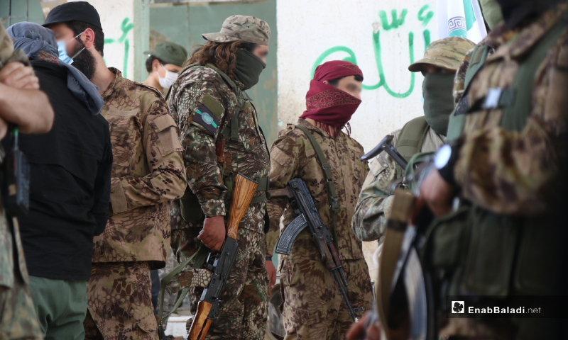 Members of the Hay' at Tahrir al-Sham (HTS) during the prisoners' exchange process between the Syrian regime and the HTS – 16 May 2020 (Enab Baladi / Yousef Ghuraibi)