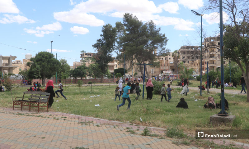 Children playing at one of the parks of al-Raqqa province, north-eastern Syria, during the Eid al-Fitr holiday – 26 May 2020 (Enab Baladi)