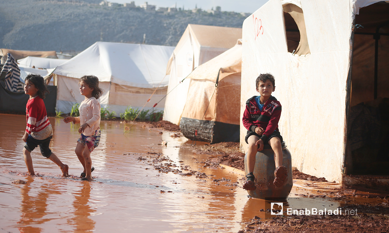 "Children of ""Sahl al-Khair"" camp for Syrian internally displaced people (IDPs) after the rainstorm near Kafr Bunni in northern Idlib countryside – 19 June 2020  (Enab Baladi / Yousef Ghuraibi)"