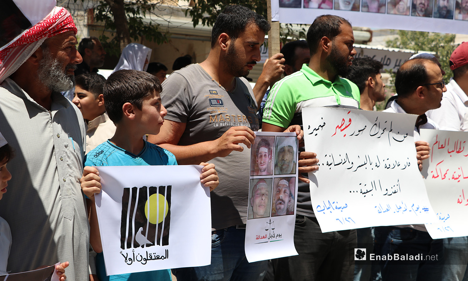 "The residents of al-Bab city of eastern Aleppo organize a protest stand in solidarity with Syrian detainees under the slogan ""Day for Justice""– 26 June 2020 (Enab Baladi / Asim Melhem)"