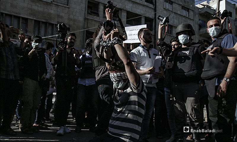 A protest stand against the repeated attacks by military forces on journalists and photographers in northern Syria - 10 June 2020 (Enab Baladi / Yousef Ghuraibi)