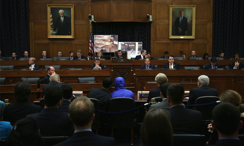 The defected Syrian officer, known as Caesar, wearing a hood, testifies before the U.S. House Committee on Foreign Affairs on Capitol Hill in Washington, DC- 31 July 2014 (Getty)