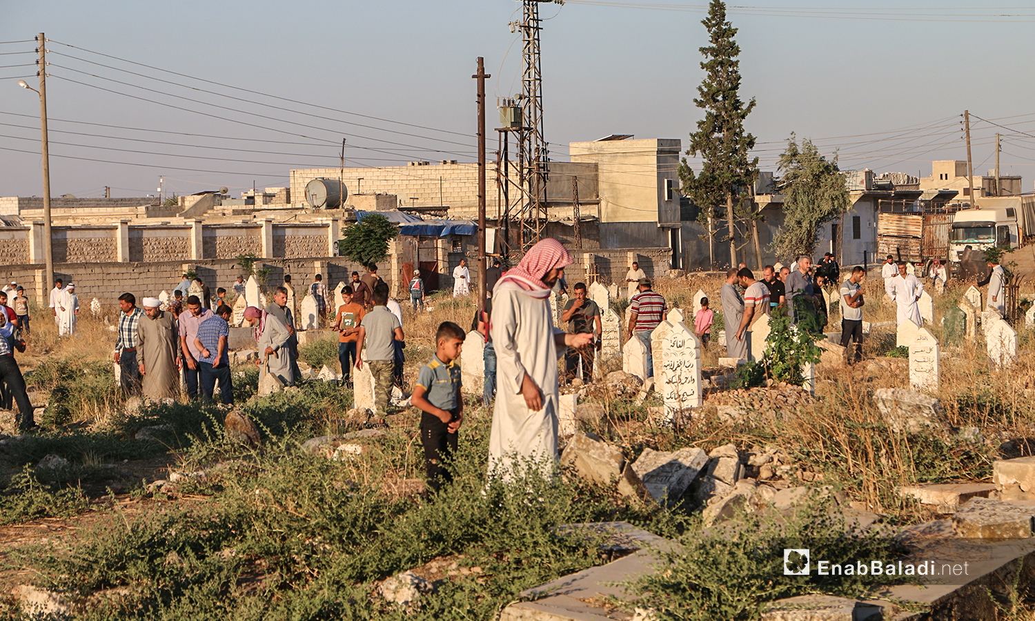 The residents of Dabiq town in northern Aleppo countryside visiting their relatives' graves in the first day of Eid al-Adha – 31 July 2020 (Enab Baladi / Abdul Salam Majan)